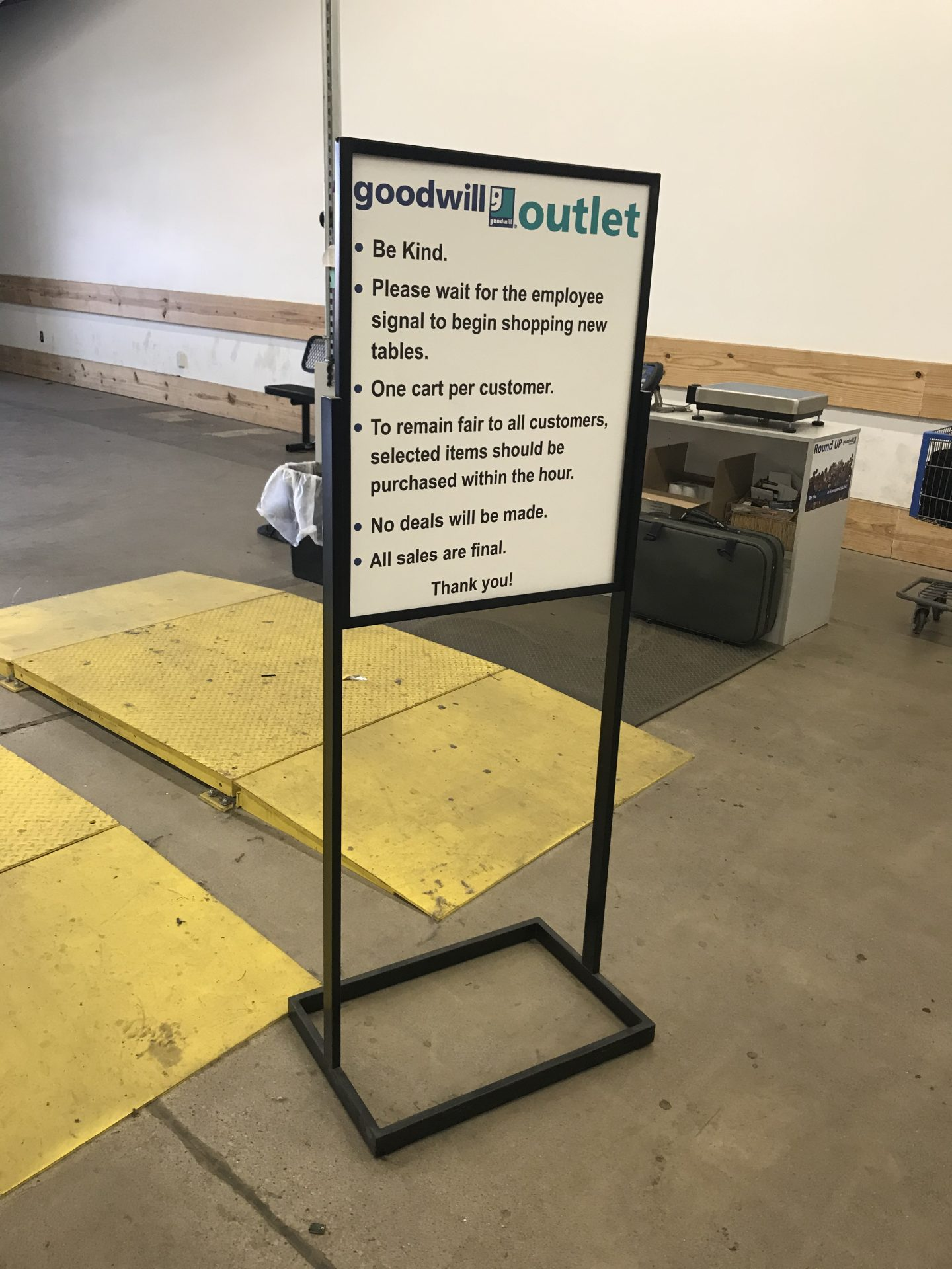 The posted code of conduct from a Goodwill outlet store